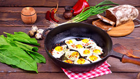 Fried eggs in a black cast-iron frying pan Stock Image
