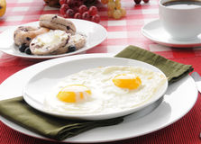 Fried eggs and blueberry bagles Royalty Free Stock Photos