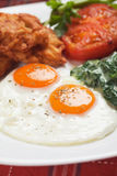 Fried eggs for breakfast Stock Images