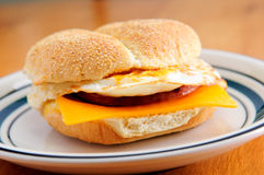 Fried eggs on a bun with cheese and sausage patty Royalty Free Stock Images