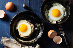 Fried eggs in cast-iron skillets Royalty Free Stock Photo