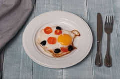 Fried eggs with cherry tomatoes and olives Stock Image
