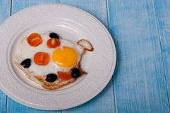 Fried eggs with cherry tomatoes and olives Stock Photo