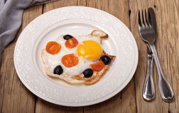 Fried eggs with cherry tomatoes and olives Royalty Free Stock Photos
