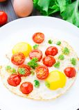 Fried eggs with cherry tomatoes Royalty Free Stock Photo