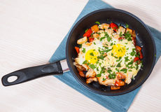 Fried eggs with chicken breast, pepper and cheese Stock Photography