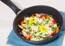 Fried eggs with chicken breast, pepper and cheese Stock Photo