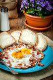 Fried eggs with chopped sausage. Stock Photos