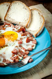 Fried eggs with chopped sausage. Royalty Free Stock Image