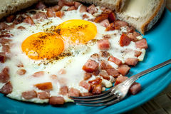 Fried eggs with chopped sausage. Royalty Free Stock Photography