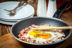 Fried eggs with chopped sausage. Stock Photo
