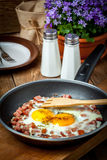 Fried eggs with chopped sausage. Stock Photography