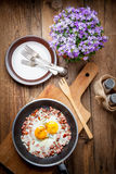 Fried eggs with chopped sausage. Royalty Free Stock Photo