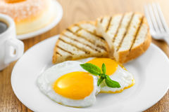 Fried eggs. With coffee. Traditional healthy food for breakfast Royalty Free Stock Photo