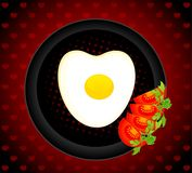 Fried eggs on a dish are decorated a tomato Royalty Free Stock Image
