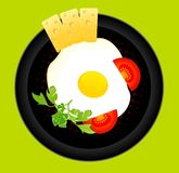 Fried eggs on a dish are decorated a tomato and c Royalty Free Stock Photos