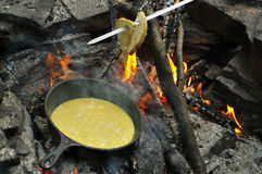 Fried eggs on fire at iron fried pan Royalty Free Stock Photography