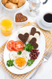 Fried eggs in the form of heart for breakfast Valentine's Day Royalty Free Stock Images