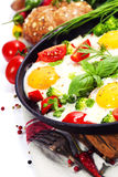 Fried eggs with fresh vegetables Royalty Free Stock Image