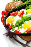 Fried eggs with fresh vegetables Stock Images