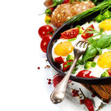 Fried eggs with fresh vegetables Stock Photography