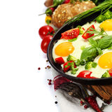 Fried eggs with fresh vegetables Royalty Free Stock Photos