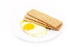 Fried eggs and fried bread Stock Photos