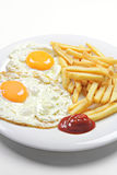 Fried eggs with fries Royalty Free Stock Image