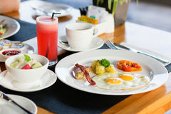 Fried eggs, fruit salad and fresh watermelon juice Royalty Free Stock Images