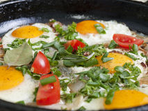 Fried eggs in a frying pan Stock Photography
