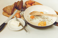 Fried Eggs in the Frying Pan,Breakfast Ingredients.Orange,Bread,Butter.Kitchen Accessories.Cooking Morning Food.Selective Focus Royalty Free Stock Photography