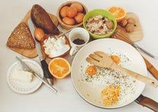 Fried Eggs in the Frying Pan,Breakfast Ingredients.Orange,Bread, Stock Image
