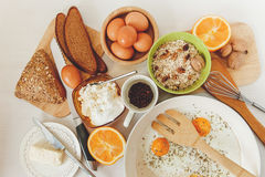 Fried Eggs in the Frying Pan,Breakfast Ingredients.Orange,Bread,Butter,Porrige,Beans Coffe.Kitchen Accessories.Cooking Morning Foo Stock Photography