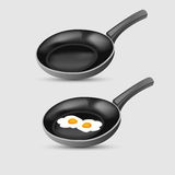 Fried eggs on frying pan Royalty Free Stock Images
