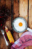 Fried eggs in a frying pan on wooden background. Breakfast. Healthy food. Fried eggs. Fried egg on a pan . Rustic food style. Ripe Stock Image