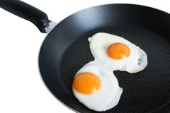 Fried eggs on griddle Stock Photos