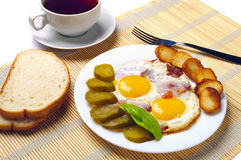 Fried eggs with ham Royalty Free Stock Images