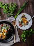 Fried eggs with ham and herbs Stock Images