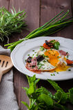 Fried eggs with ham and herbs Royalty Free Stock Photos
