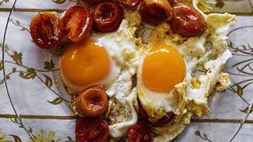 Fried eggs, healthy, breakfast, vegetable, fried, tomato royalty free stock image