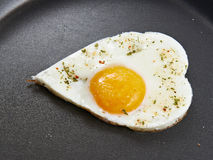 Fried eggs in heart form Royalty Free Stock Photos