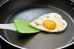 Fried eggs in heart form Stock Image