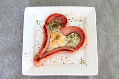 Fried eggs heart , sausages hearts Royalty Free Stock Image