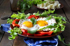 Fried eggs with herbs and paprika for breakfast Royalty Free Stock Photos