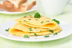 Fried eggs with herbs Stock Photo