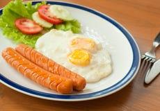 Fried eggs with hotdog Stock Image
