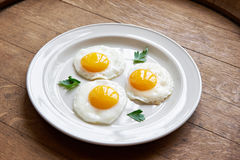 Free Fried Eggs In Plate On Table Stock Images - 71487204