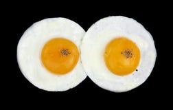 Fried Eggs Like Eyes Stock Images