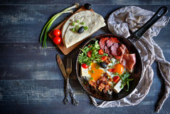Fried eggs and meat Stock Photos