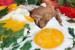 Fried eggs with meat and vegetables Royalty Free Stock Photo